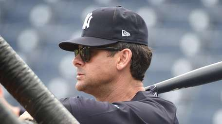 Yankees Manager Aaron Boone watches batting practice during