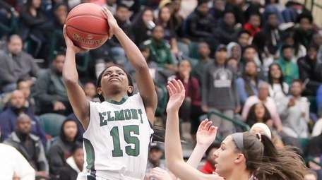 Elmont's Zhaneia Thybulle (15) puts one up and
