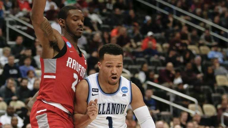 Villanova's Jalen Brunson (1) drives on Radford's Ed