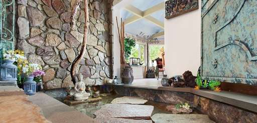 The Peconic home has a gunite pool with