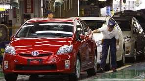 A Toyota Motor Corp. worker gives the final