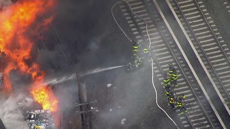 Fire breaks out near LIRR tracks in Queens; multiple lines suspended