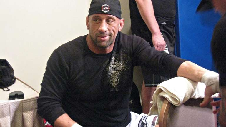 Mark Coleman gets his hands taped before a
