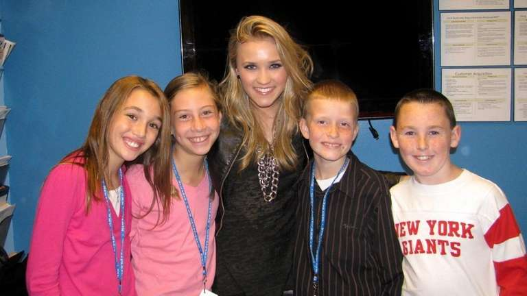 Singer / actress Emily Osment with Kidsday reporters