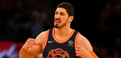 Enes Kanter reacts after a basket in the