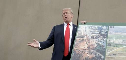 President Donald Trump speaks during a tour as