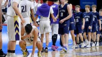 Greenport's Jordan Fonseca, left, reacts to the Porters'