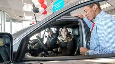 Atlantic Jeep salesman Vincent Smythe speaking with Michelle