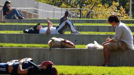 Students relax in the sun on the SUNY