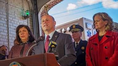 Nassau County Police Commissioner Patrick Ryder, flanked by