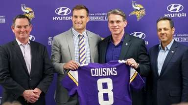 Vikings quarterback Kirk Cousins, second from left, poses