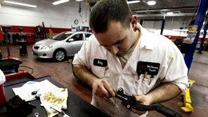 Bobby Rewoldt II, line technician installs a shim