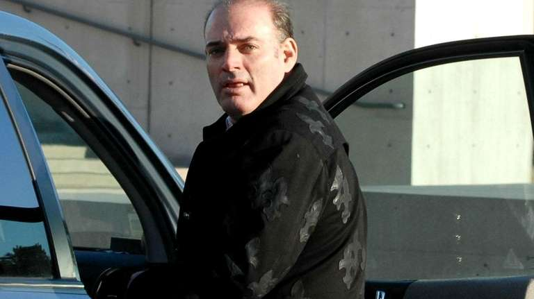 David Brooks leaves federal court in Central Islip.