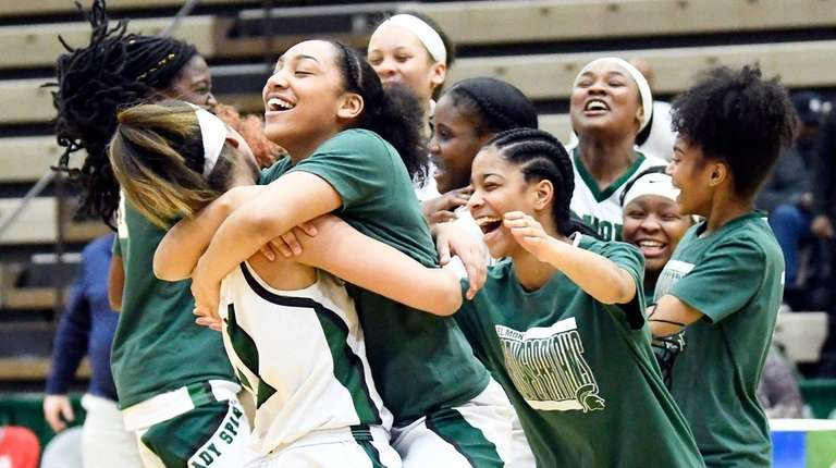 Elmont players celebrate a 70-61 win over Williamsville
