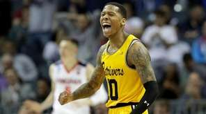 Jairus Lyles of UMBC reacts after a score