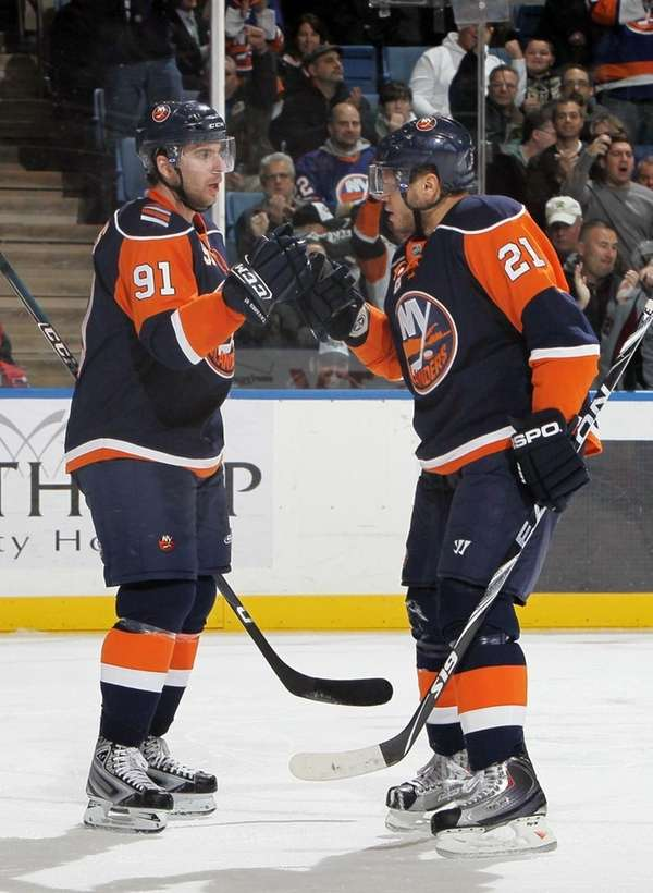 Kyle Okposo, right, celebrates his goal against the