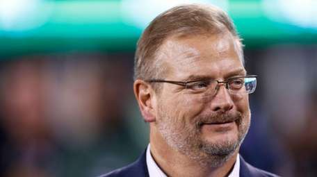 Jets general manager Mike Maccagnan stands on the