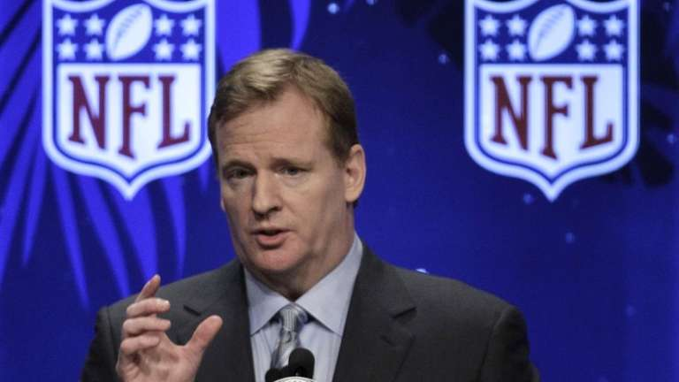 NFL Commissioner Roger Goodell answers a question during