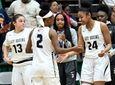 Baldwin players celebrate a 65-49 win against Bishop