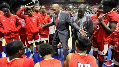 Amityville head coach Gordon Thomas talks to his