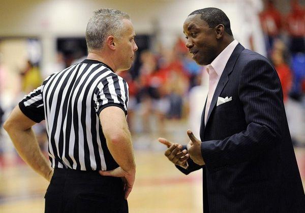 Florida International head coach Isiah Thomas talks with