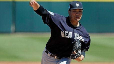Yankees pitcher Masahiro Tanaka throws in the first