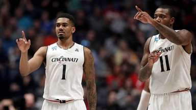 Cincinnati guard Jacob Evans and forward Gary Clark