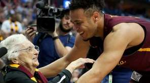 Marques Townes of Loyola-Chicago celebrates with Sister Jean