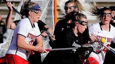 Stony Brook's Emma Schait stick checks the ball
