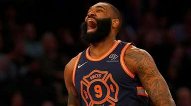Kyle O'Quinn of the Knicks reacts after a