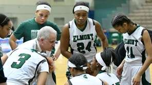 Elmont head coach Tom Magno instructs his players