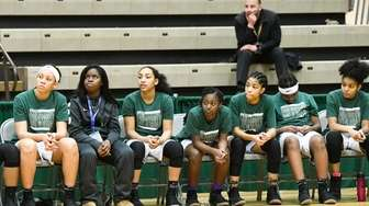 Elmont Memorial players react after a 64-51 loss
