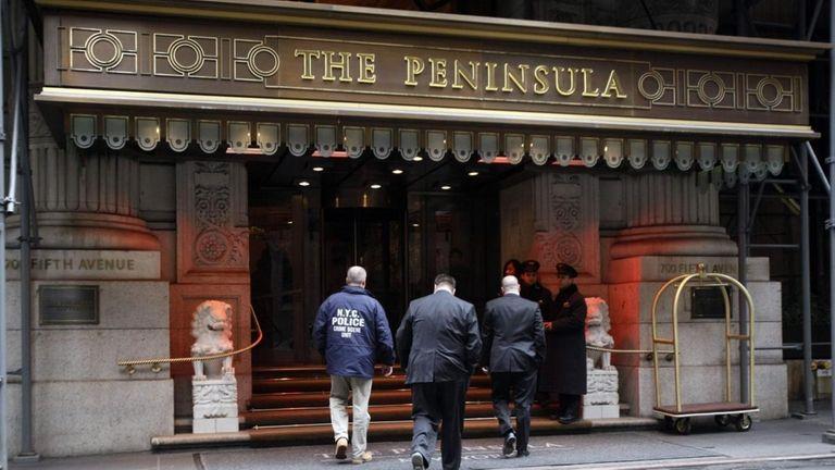 New York Police detectives enter the Peninsula Hotel