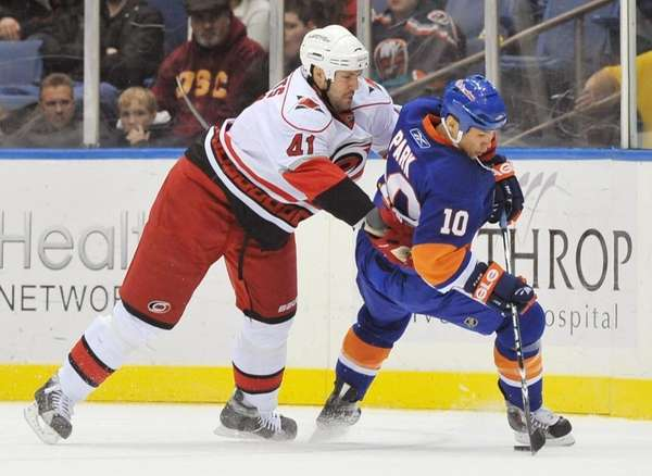 Carolina's Andrew Alberts (41) moves in on Islanders'