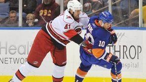 Carolina's Andrew Alberts (41) moves in on Islanders'