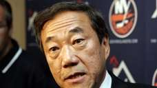 Islanders owner Charles Wang responds to questions during