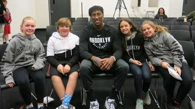 Brooklyn Nets player Rondae Hollis-Jefferson with Kidsday reporters,