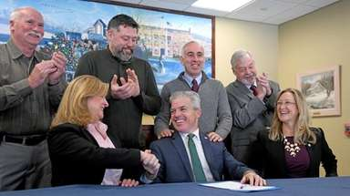 County Executive Steve Bellone, center, is congratulated Sunday