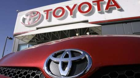 The Toyota logo hangs over the logo of