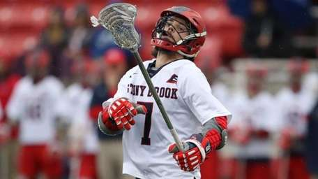 Stony Brook's Jack Walsh looks to control the