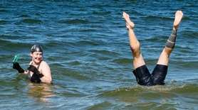 A participant does a handstand under water during
