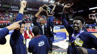 Amityville head coach Gordon Thomas accepts the championship