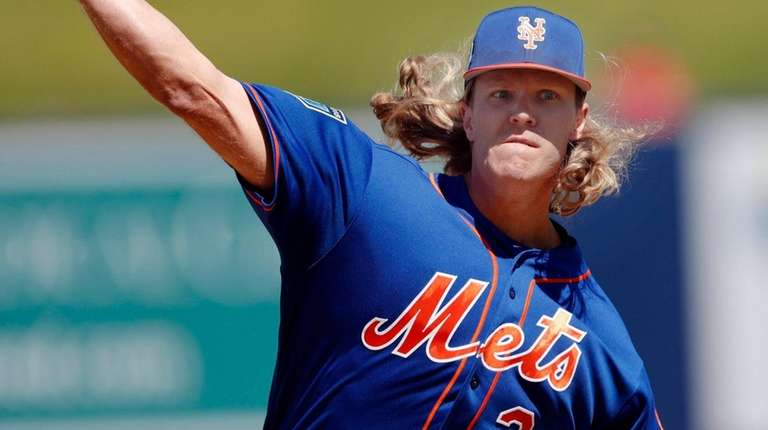 Mets starting pitcher Noah Syndergaard works in the