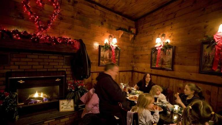 A family lingers over a cozy dinner by