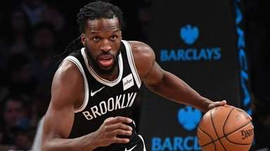 Nets forward DeMarre Carroll dribbles the ball up