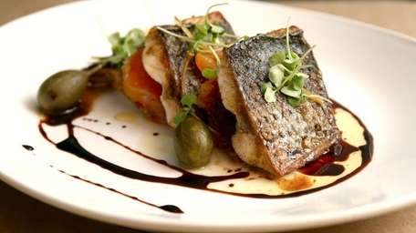 Venue 56's farm-raised striped bass, $29, is served