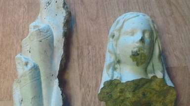 The damaged Virgin Mary statue at Church of