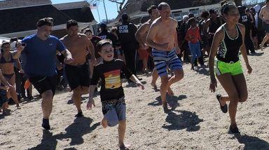 Christopher Todaro, left, follows his son Christian and
