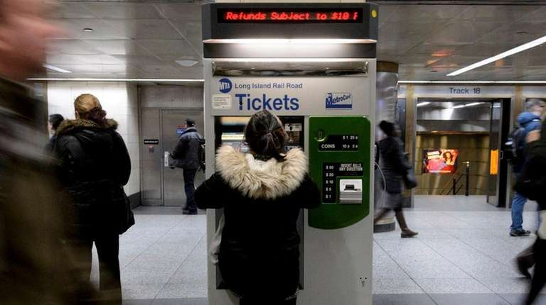 Long Island Rail Road passengers purchase tickets at
