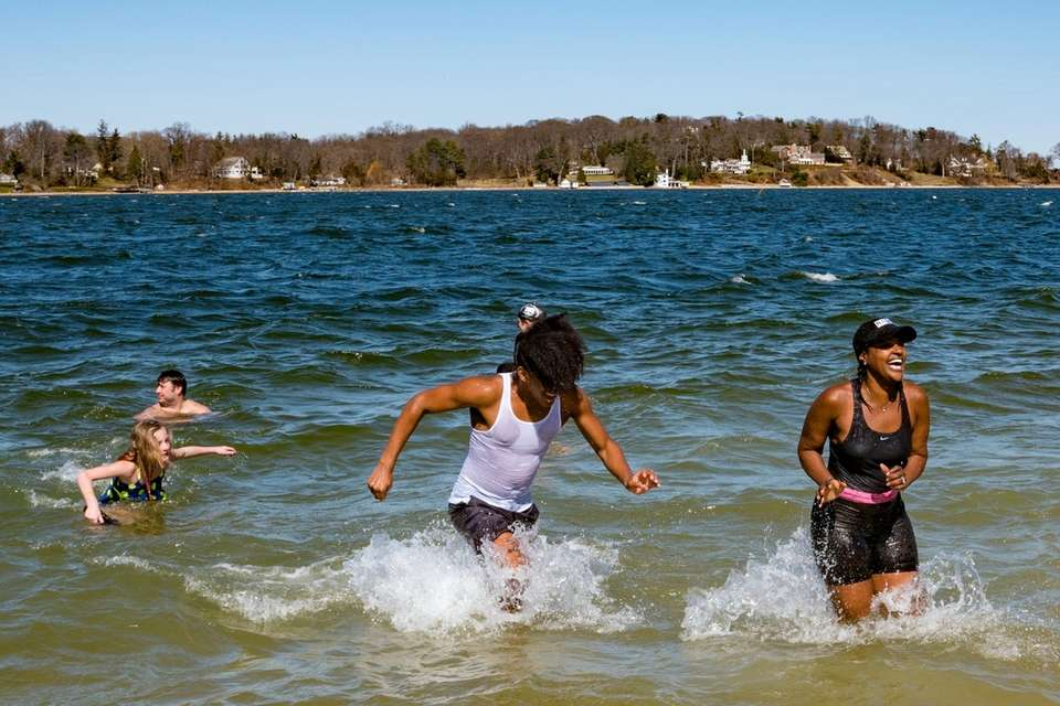Plungers take to the frigid water during the